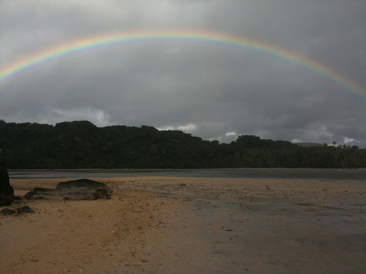 Rainbow as seen from shore of island near Papageno Resort.