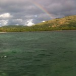 Rainbow as seen from kayak near island near Papageno Resort.