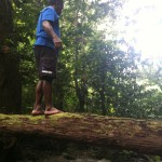 Our guide Zachariah balances on a fallen tree limb.