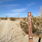Sign post on dirt road pointing to the slot canyon in Anza Borrego Desert State Park.